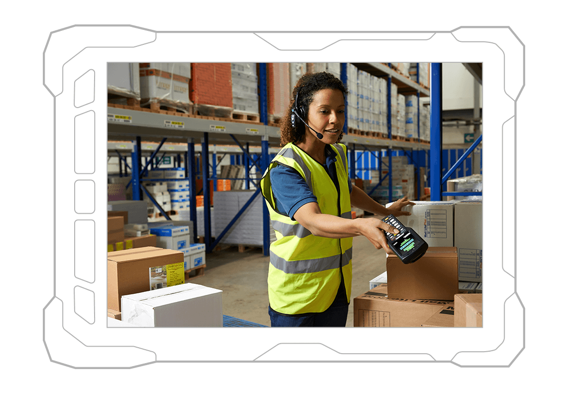 worker in warehouse scanning boxes